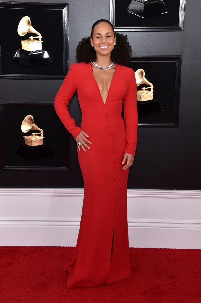 <p>The night's host, Alicia Keys, arrived in a swanky red button-up dress for the important gig. While she's not nominated for any awards this year, Keys has enough Grammys to fill a mantle at home. </p>