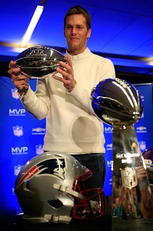 Tom Brady is appealing a four-game suspension for his role in deflate-gate. (Getty Images)
