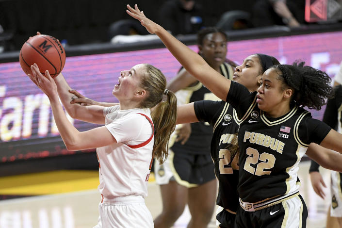 Maryland guard Taisiya Kozlova (14) shoots in front of Purdue guard Jenelle Grant (22) and center Ra Shaya Kyle (24) during the second half of an NCAA college basketball game, Sunday, Jan. 10, 2021, in College Park, Md. (AP Photo/Will Newton)