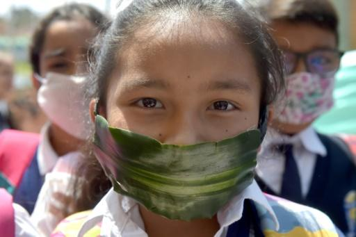 A student in Soacha, Colombia wears a mask made of recyclable and biodegradable materials as a form of protest against the shortage of face masks in pharmacies against the coronavirus