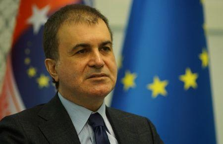 Turkey's Minister for EU Affairs Omer Celik reacts during an interview with Reuters in Ankara