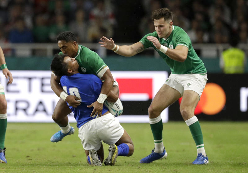 Ireland's Bundee Aki hits Samoa's Ulupano Seuteni in a high tackle during the Rugby World Cup Pool A game at Fukuoka Hakatanomori Stadium between Ireland and Samoa, in Fukuoka, Japan, Saturday, Oct. 12, 2019.Aki received a red card for this tackle. (AP Photo/Aaron Favila)
