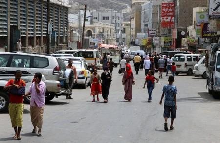 FILE PHOTO: People walk on a street in Aden