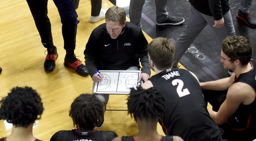 Gonzaga coach Mark Few speaks with his team during a timeout in the second half of an NCAA college basketball game against Portland in Portland, Ore., Saturday, Jan. 9, 2021. (AP Photo/Steve Dykes)