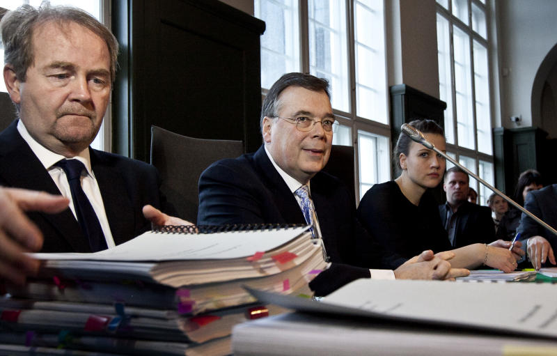 Former Prime Minister of Iceland Geir Haarde, centre. sits in a court in Reykjavik Monday March 5, 2012 . Iceland's former prime minister went on trial Monay as the first world leader to face criminal charges over the 2008 financial crisis that affected much of the world economy. Geir Haarde became a symbol of the bubble economy for Icelanders who lost their jobs and homes after the country's main commercial bank collapsed in 2008, sending its currency into a nosedive and inflation soaring. (AP Photo/Kristinn Ingvarsson) ICELAND OUT