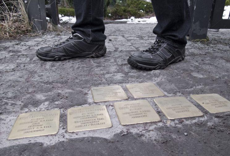 The Stolperstein, or 'stumbling stones,' have been installed throughout Germany by artist Gunter Demnig since the '90s as a memorial to Holocaust victims. Photo from Getty Images