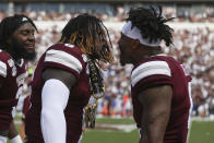Mississippi State linebacker Willie Gay, Jr., left, celebrates a pick-six against Kentucky with Mississippi State running back Kylin Hill (7) during the first quarter of an NCAA college football game against Kentucky, Saturday, Sept. 21, 2019, in Starkville, Miss. (AP Photo/Kelly Donoho)