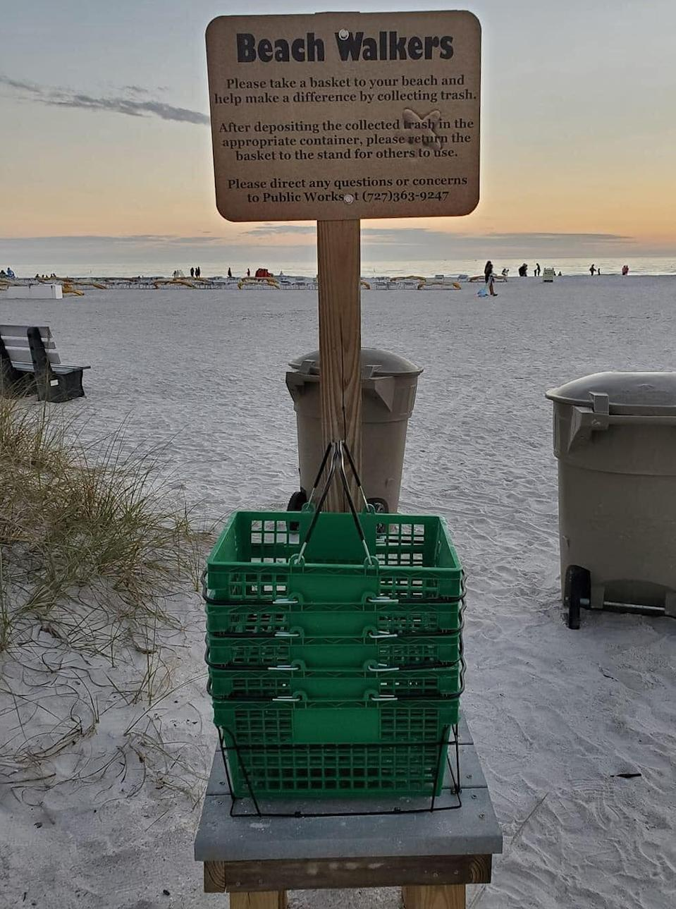Supermarket baskets placed at the beach to ask volunteers to help clean up the area