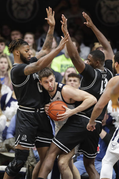 Butler forward Bryce Golden (33) is trapped between Providence center Nate Watson (0) and forward Kalif Young (13) in the second half of an NCAA college basketball game in Indianapolis, Saturday, Feb. 1, 2020. Providence defeated Butler 65-61. (AP Photo/Michael Conroy)