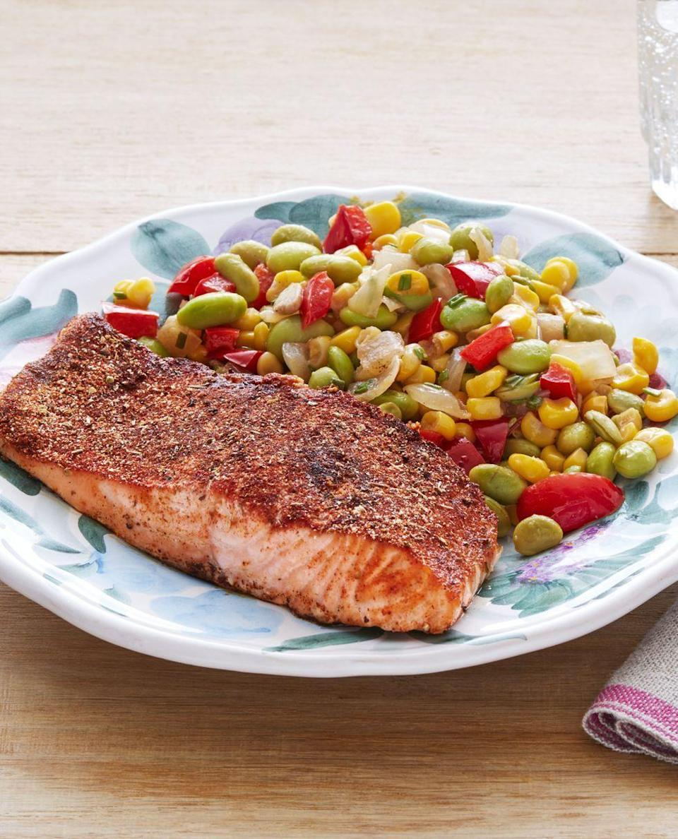"""<p>Borrow Ree's sheet-pan method for making blackened salmon and you'll have this tasty, flavorful dinner on the table in just 30 minutes. This fish pairs perfectly with a side of buttery sautéed vegetables.</p><p><a href=""""https://www.thepioneerwoman.com/food-cooking/recipes/a32675215/blackened-salmon-with-edamame-succotash-recipe/"""" rel=""""nofollow noopener"""" target=""""_blank"""" data-ylk=""""slk:Get Ree's recipe."""" class=""""link rapid-noclick-resp""""><strong>Get Ree's recipe.</strong></a> </p>"""