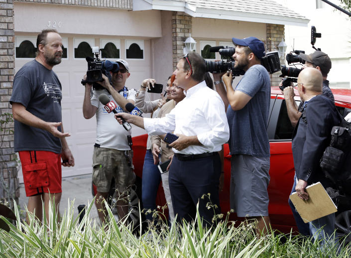 """Eric Paddock, left, brother of Las Vegas gunman Stephen Paddock, speaks to members of the media outside his home in Orlando, Fla. Paddock told the Orlando Sentinel: """"We are completely dumbfounded. We can't understand what happened."""" (Photo: John Raoux/AP)"""