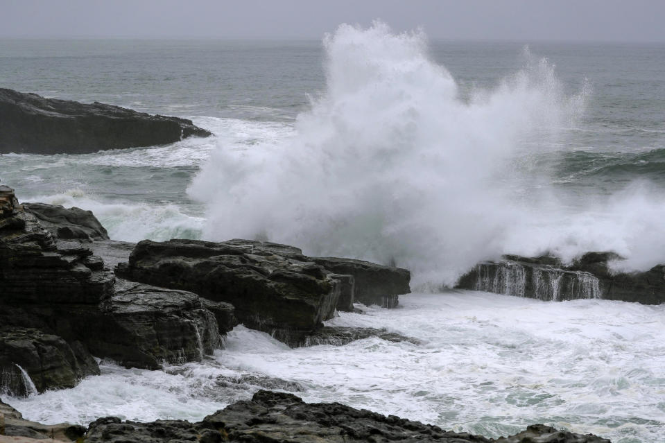 Waves hit the shore in Shirahama, Wakayama prefecture, central Japan, Friday, Oct. 9, 2020, as Typhoon Chan-hom approaches. A slow-moving typhoon off Japan's southern coast has triggered gusts and rain across a large part of the country and could bring heavy rains to the Tokyo region early next week, though it was not expected to make landfall, officials said Friday.(Kyodo News via AP)