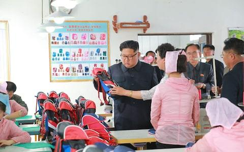 Kim also inspected the Chongjin Bag Factory in North Hamgyong Province - Credit: AFP