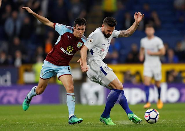 "Soccer Football - Premier League - Burnley vs Chelsea - Turf Moor, Burnley, Britain - April 19, 2018 Chelsea's Olivier Giroud in action with Burnley's Jack Cork Action Images via Reuters/Andrew Boyers EDITORIAL USE ONLY. No use with unauthorized audio, video, data, fixture lists, club/league logos or ""live"" services. Online in-match use limited to 75 images, no video emulation. No use in betting, games or single club/league/player publications. Please contact your account representative for further details."