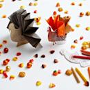 """<p>Here's an activity that can double as a pretty place card <em>and</em> a napkin ring all in one. Cut out the turkey, arrange the napkin within it as pictured, then set out a few crayons and let the fun begin!</p><p><strong>Get the tutorial at <a href=""""http://www.darcymillerdesigns.com/ideas/turkey-tail-napkin-rings/"""" rel=""""nofollow noopener"""" target=""""_blank"""" data-ylk=""""slk:Darcy Miller Designs"""" class=""""link rapid-noclick-resp"""">Darcy Miller Designs</a>. </strong></p><p><strong><a class=""""link rapid-noclick-resp"""" href=""""https://www.amazon.com/Crayola-Bulk-Crayons-52-3008-12-Pack/dp/B002OF2C50?tag=syn-yahoo-20&ascsubtag=%5Bartid%7C10050.g.1201%5Bsrc%7Cyahoo-us"""" rel=""""nofollow noopener"""" target=""""_blank"""" data-ylk=""""slk:SHOP CRAYONS"""">SHOP CRAYONS</a><br></strong></p>"""