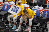 Los Angeles Lakers center Marc Gasol lowers his head while sitting next to Alex Caruso on the bench during the second half of the team's NBA basketball game against the Utah Jazz on Wednesday, Feb. 24, 2021, in Salt Lake City. (AP Photo/Rick Bowmer)