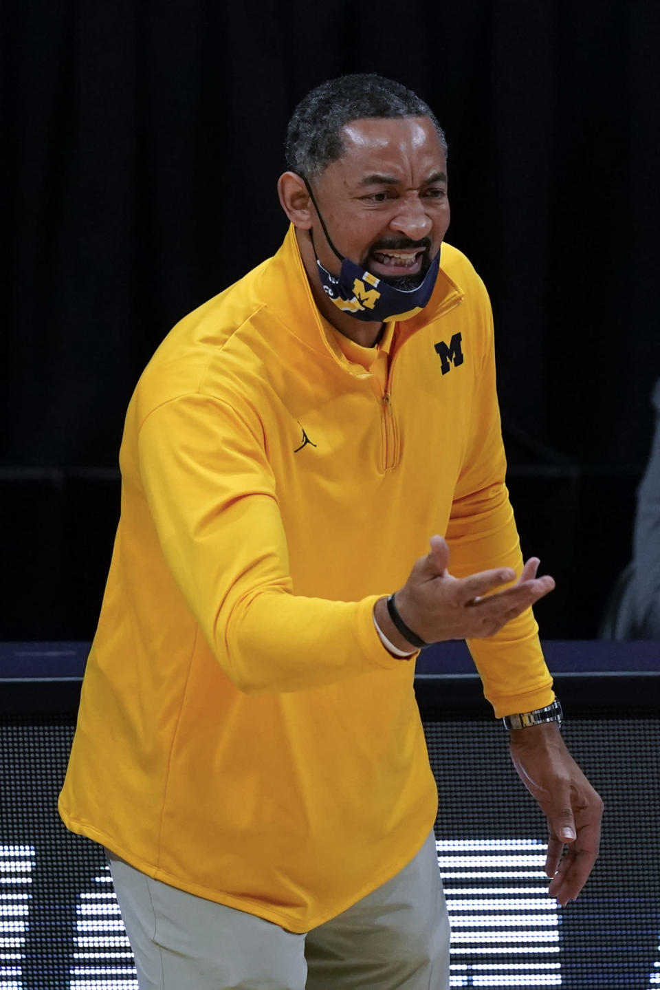 Michigan head coach Juwan Howard reacts to a call during the first half of an Elite 8 game against UCLA in the NCAA men's college basketball tournament at Lucas Oil Stadium, Tuesday, March 30, 2021, in Indianapolis. (AP Photo/Michael Conroy)