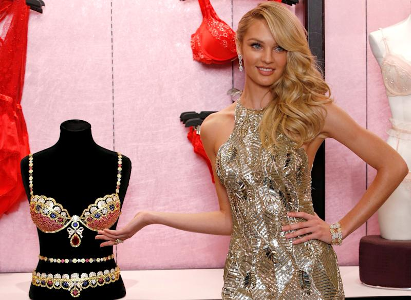 Victoria's Secret model Candice Swanepoel poses for photographers with the Royal Fantasy Bra gift set, valued at $10 million during a photo opportunity at the Victoria's secret store in New York City on Nov. 6, 2013.