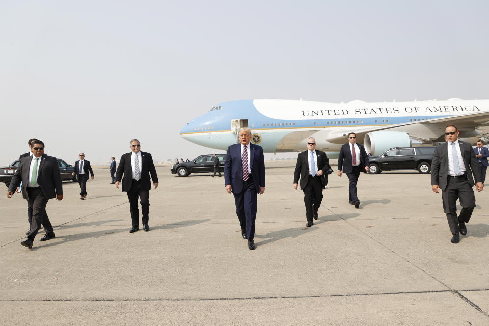 US President Donald Trump walks towards the media platform surrounded by his secret service detail. Source: AAP