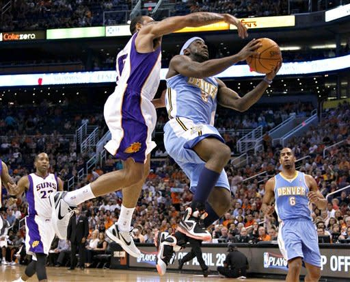 Denver Nuggets' Ty Lawson (3) drives past Phoenix Suns' Shannon Brown during the first half of an NBA basketball game on Saturday, April 21, 2012, in Phoenix. (AP Photo/Matt York)