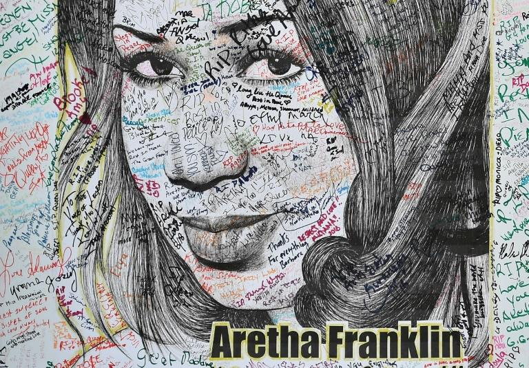 An Aretha Franklin poster signed by fans hangs outside the Charles H. Wright Museum of African American History in Detroit