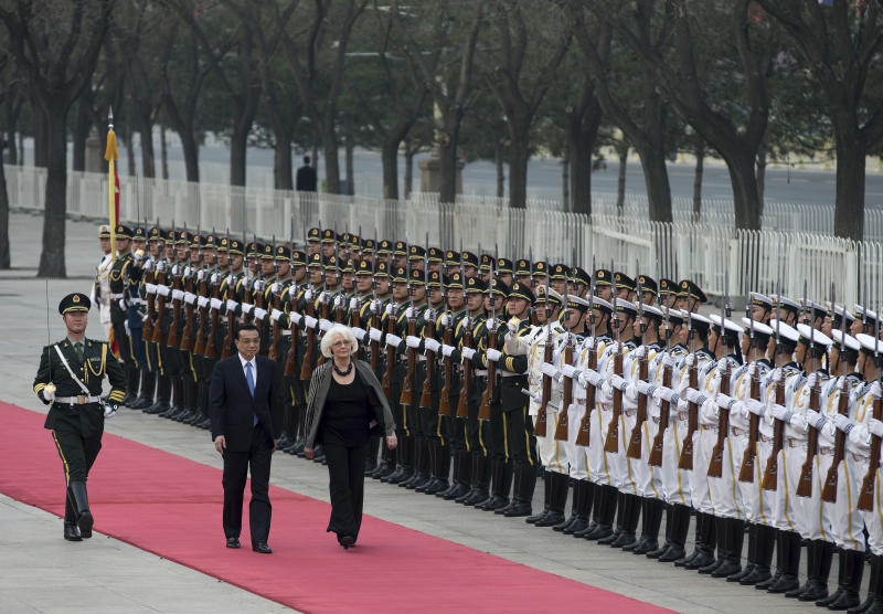 Iceland's Prime Minister Johanna Sigurdardottir, right, and Chinese Premier Li Keqiang inspect a guard of honor during a welcome ceremony outside the Great Hall of the People in Beijing Monday, April 15, 2013. (AP Photo/Andy Wong)