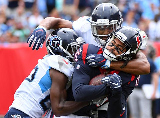 <p>Houston Texans wide receiver Will Fuller (15) is tackled by Tennessee Titans linebacker Wesley Woodyard (59) and Tennessee Titans cornerback Adoree' Jackson (25) after a reception during the first half at Nissan Stadium. Mandatory Credit: Christopher Hanewinckel-USA TODAY Sports </p>