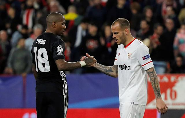 Soccer Football - Champions League Round of 16 First Leg - Sevilla vs Manchester United - Ramon Sanchez Pizjuan, Seville, Spain - February 21, 2018 Sevilla's Sandro Ramirez shakes hands with Manchester United's Ashley Young after the match REUTERS/Jon Nazca