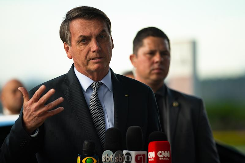 BRASILIA, BRAZIL - MARCH 17: Brazilian President Jair Bolsonaro speaks with press before meet with supporters amid the COVID-19 outbreak (COVID - 19) at the Palacio do Alvorada March, 17, 2020 in Brasilia, Brazil. Bolsonaro has already done two tests for COVID-19, the first was negative and now awaits the result of the second. The examinations were done after a scare over a trip on which at least one member of his staff came back positive and was in contact with US President Donald Trump. (Photo by Andressa Anholete / Getty Images)