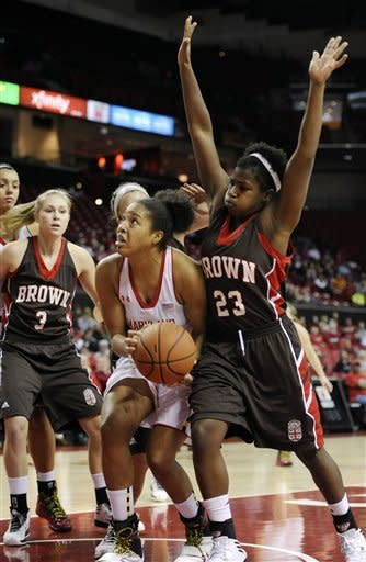 Maryland's Tianna Hawkins looks to shoot as Brown's Sheila Dixon (23) defends in the first half of an NCAA college basketball game Friday, Dec. 28, 2012 in College Park, Md. Maryland won 76-36.(AP Photo/Gail Burton)