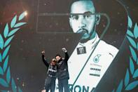 Hamilton celebrates with Mercedes boss Toto Wolff