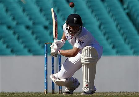 England's Jonathan Trott ducks under a delivery during the warm-up match against the Cricket Australia Invitational XI at the Sydney Cricket Ground November 14, 2013. REUTERS/David Gray
