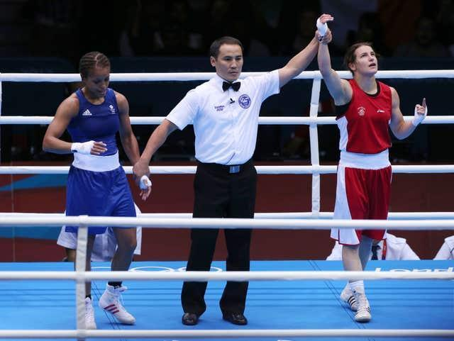 Katie Taylor, right, beat Natasha Jonas, left, in their lightweight quarter-final at the London Olympics nine years ago (Nick Potts/PA)