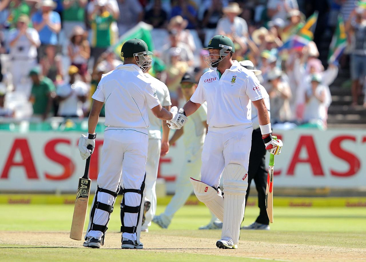 CAPE TOWN, SOUTH AFRICA - JANUARY 02: Jacques Kallis is congratulated by Alviro Petersen of the Proteas after becoming only the fourth batsman in history to score 13,000 runs in Test cricket during day 1 of the 1st Test between South Africa and New Zealand at Sahara Park Newlands on January 02, 2013 in Cape Town, South Africa. (Photo by Carl Fourie/Gallo Images/Getty images)