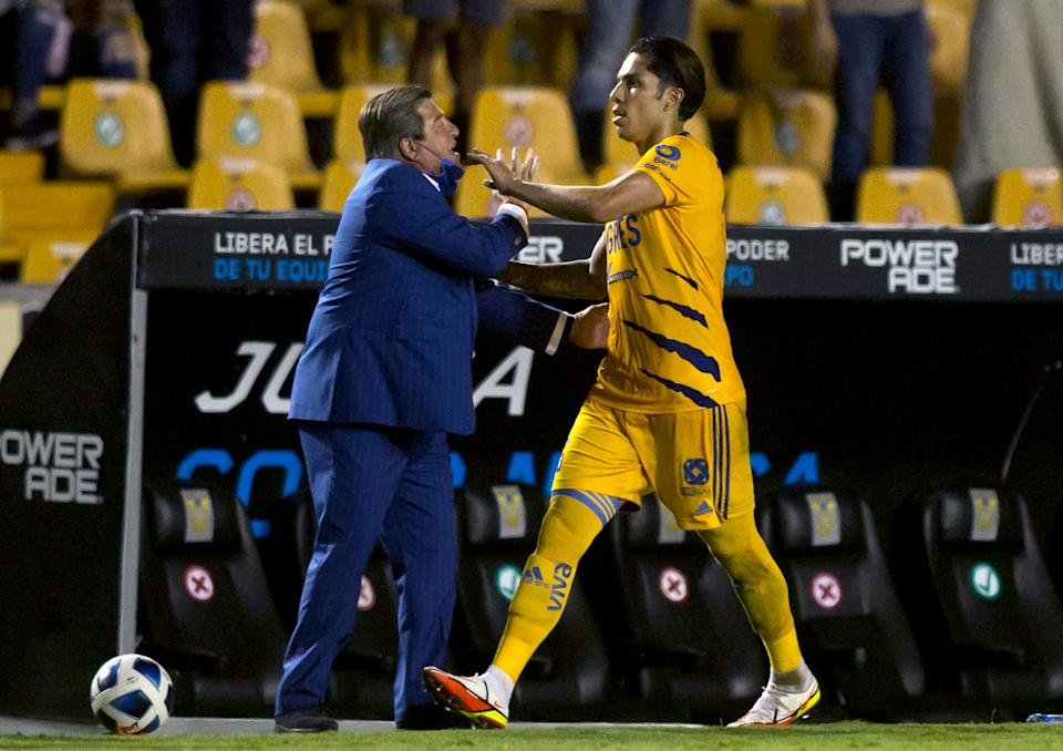 Tigres' Carlos Salcedo (R) celebrates with head coach Miguel Herrera after scoring against Santos during the Mexican Clausura 2021 tournament football match at Universitario stadium in Monterrey, Mexico, on August 7, 2021. (Photo by Julio Cesar AGUILAR / AFP) (Photo by JULIO CESAR AGUILAR/AFP via Getty Images)