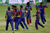 Karachi Kings players celebrates after won the match in super over during the Pakistan Super League T20 first qualifier cricket match against Multan Sultans at National Stadium in Karachi, Pakistan, Saturday, Nov. 14, 2020. (AP Photo/Fareed Khan)