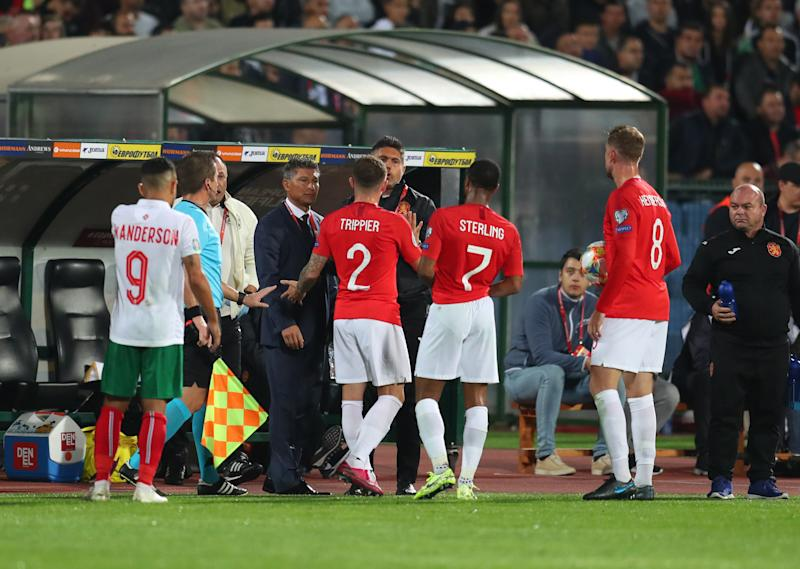 SOFIA, BULGARIA - OCTOBER 14: Raheem Sterling, Kieran Trippier and Jordan Henderson speak with Krasimir Balakov manager of Bulgaria during the UEFA Euro 2020 qualifier between Bulgaria and England on October 14, 2019 in Sofia, Bulgaria. (Photo by Catherine Ivill/Getty Images)