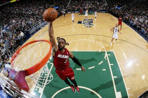SALT LAKE CITY, UT - FEBRUARY 08: Dwyane Wade #3 of the Miami Heat dunks against the Utah Jazz at EnergySolutions Arena on February 08, 2014 in Salt Lake City, Utah. (Photo by Melissa Majchrzak/NBAE via Getty Images)