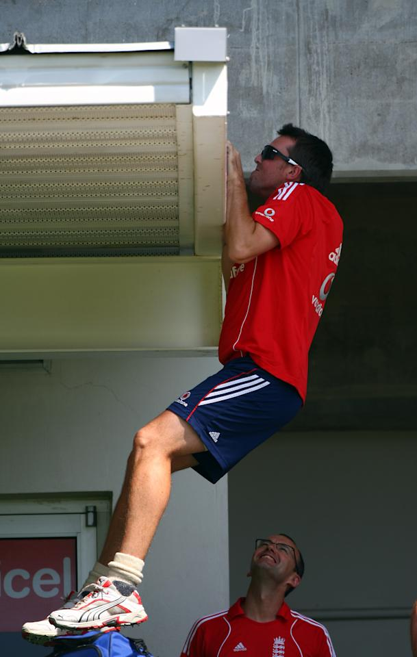 KINGSTON, JAMAICA - FEBRUARY 03:  Graeme Swann of England does pull ups on the team dressing room before a nets session at Sabina Park before the start of the 1st Test which begins tomorrow on February 3, 2009 in Kingston, Jamaica.  (Photo by Julian Herbert/Getty Images)