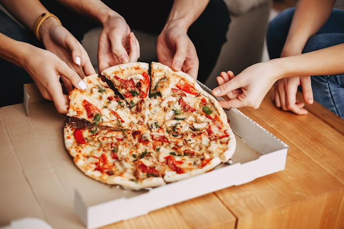 Since it's possible the coronavirus can live up to a day or two on surfaces, it's best to open your food delivery containers with gloved hands. (Photo: Vadym Petrochenko via Getty Images)