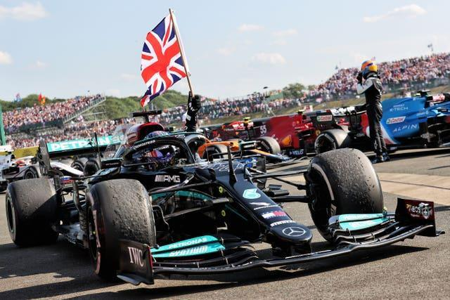 Lewis Hamilton flies the British flag after winning at Silverstone this year