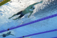 United States' Chase Kalisz swims to win the gold medal in the 400-meter individual medley at the 2020 Summer Olympics, Sunday, July 25, 2021, in Tokyo. (AP Photo/David J. Phillip)