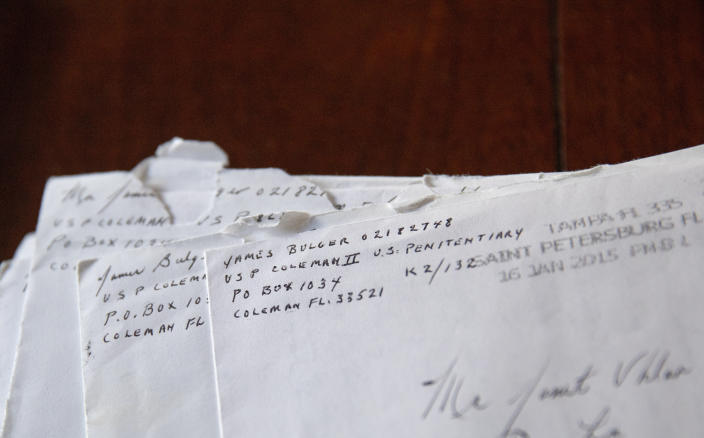 """Letters addressed to Janet Uhlar that she received through her correspondence with imprisoned Boston organized crime boss James """"Whitey"""" Bulger, sit on her dining room table, Friday, Jan. 31, 2020, in Eastham, Mass. Uhlar started writing Bulger, she said, because as a juror, she was troubled by the fact that much of the evidence against him came through testimony by former criminal associates who were also killers and had received reduced sentences in exchange for testifying against their former partner in crime. """"When I left the trial, I had more questions,"""" she said. (AP Photo/David Goldman)"""