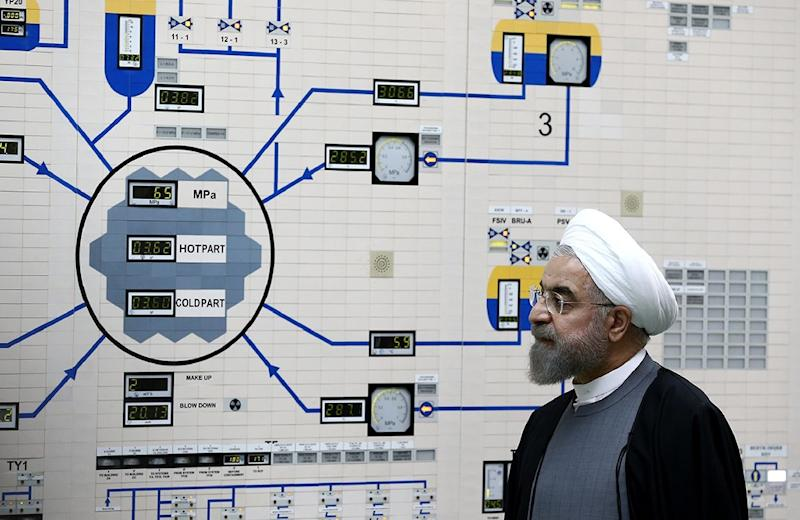 A picture released by the official website of the Iranian President Hassan Rouhani, shows the president visiting the control room of the Bushehr nuclear power plant on January 13, 2015, in Iran (AFP Photo/Mohammad Berno)