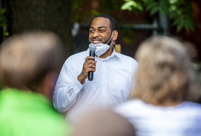 State Rep. Charles Booker smiles while speaking at a rally for Booker at Highland Coffee Company on Bardstown Road on Wednesday, June 17, 2020.