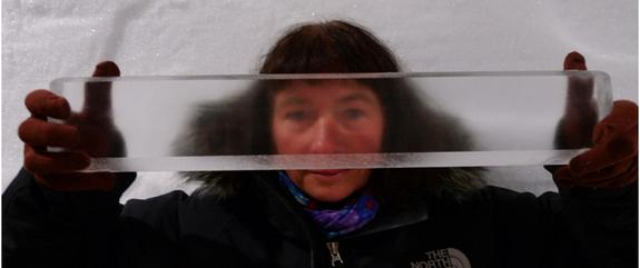 Researcher Dorthe Dahl-Jensen of the University of Copenhagen holds a piece of Greenland ice core.