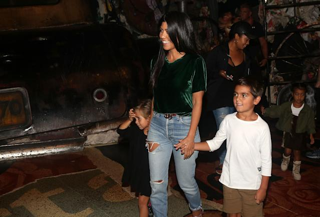 Mason Disick, right, with mother Kourtney Kardashian and sister Penelope in 2016. (Photo: Bruce Glikas/Bruce Glikas/Getty Images)