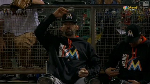 Even without his best weapon, this Marlins bullpen catcher stayed calm. (MLB.com screen shot)