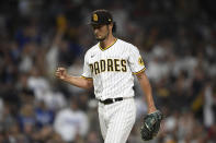 San Diego Padres starting pitcher Yu Darvish (11) pumps his fist after getting the final out during the sixth inning of a baseball game against the Los Angeles Dodgers, Monday, June 21, 2021, in San Diego. (AP Photo/Denis Poroy)