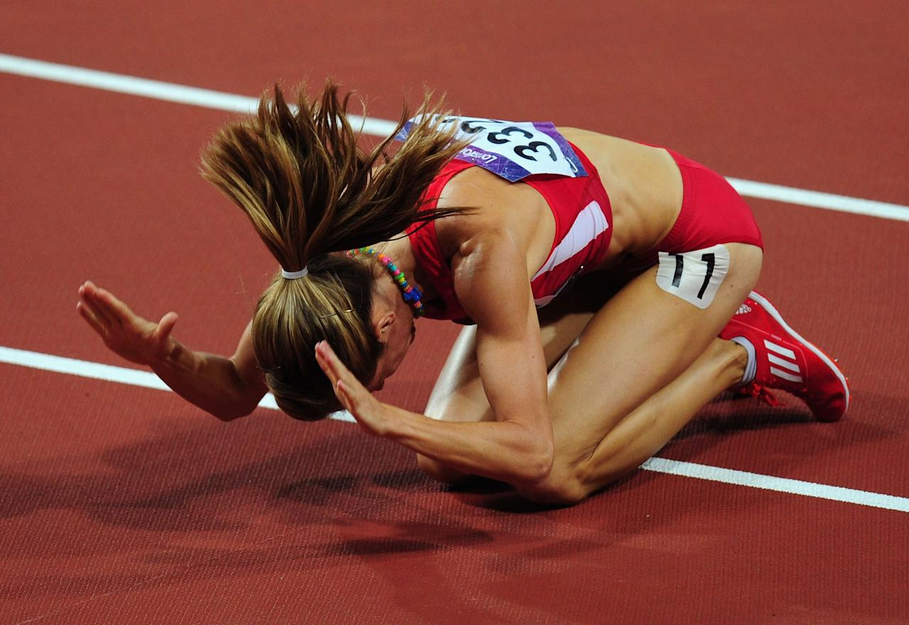 LONDON, ENGLAND - AUGUST 10:  Morgan Uceny of the United States reacts after falling during the Women's 1500m Final on Day 14 of the London 2012 Olympic Games at Olympic Stadium on August 10, 2012 in London, England.  (Photo by Stu Forster/Getty Images)